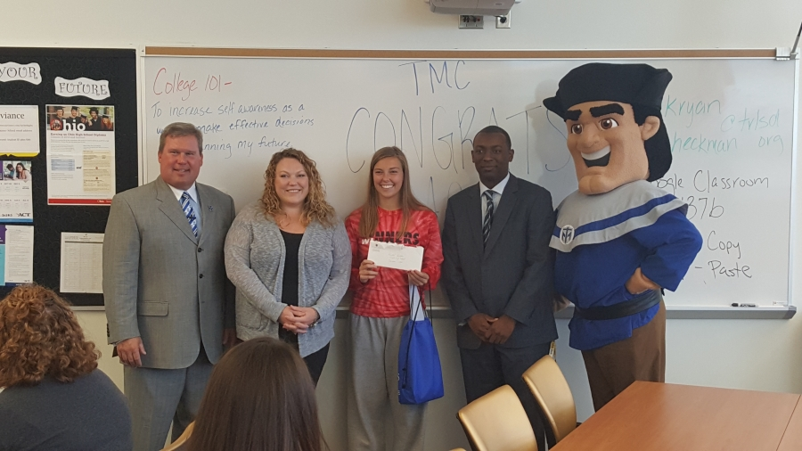 Rachel Hardtke surrounded by President of Thomas More College, Counselor, Principal and the mascot