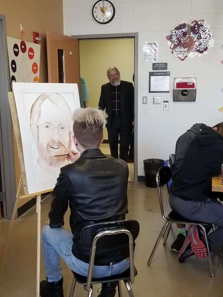 Paolo DeMaria engaging with students in a gifted classroom.