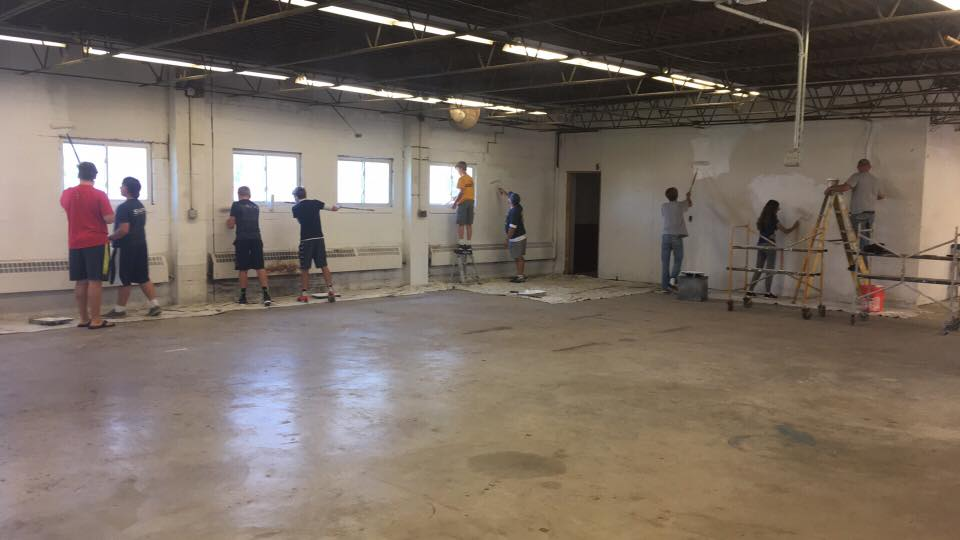Robby and friends working on the new wrestling room as part of his Eagle Scout Project.