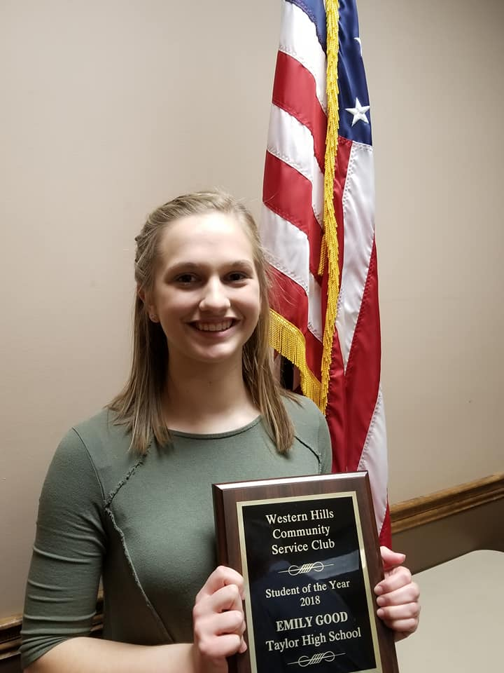 Emily Good holding plaque after receiving the Student of the Year award.