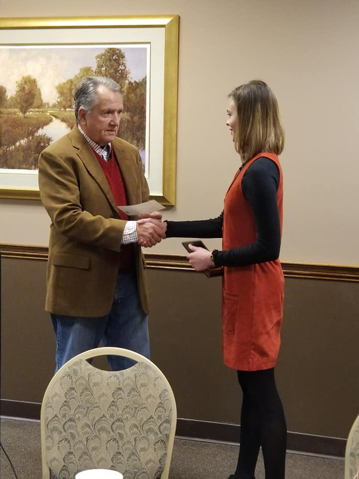 Clare Forbes receiving Western Hills Community Service Club's Student of the Month award.