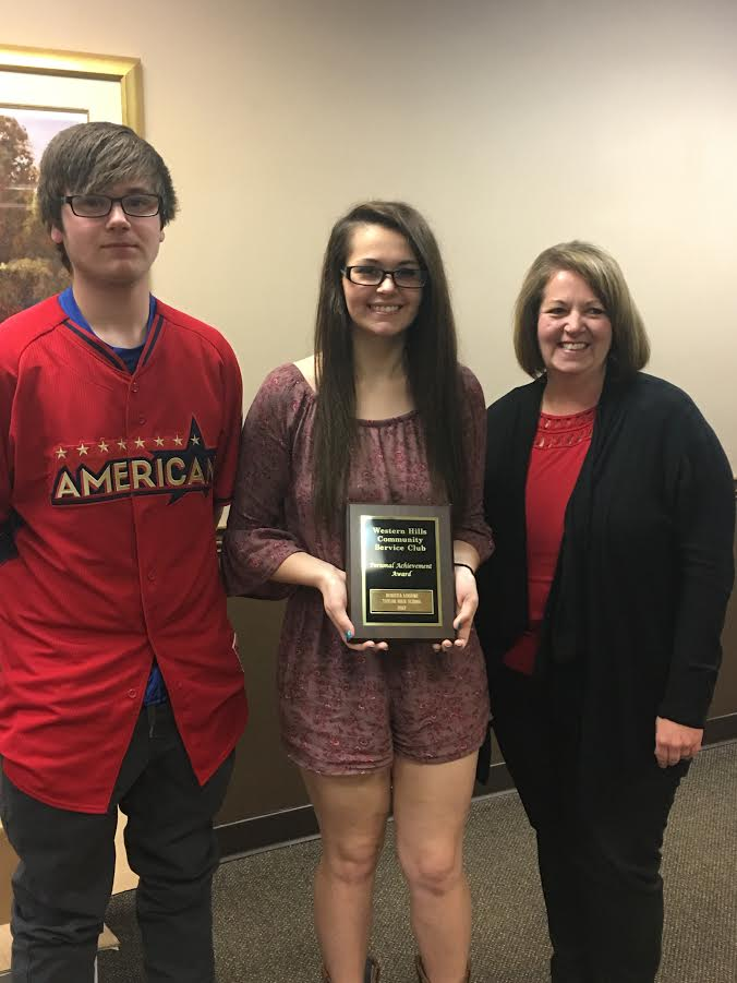 picture of taylor high school student with her family after receiving a personal achievement award