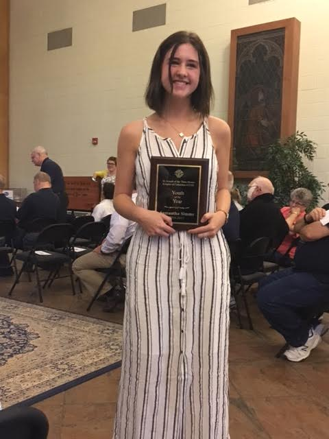 Samantha Simms receiving Knights of Columbus Award