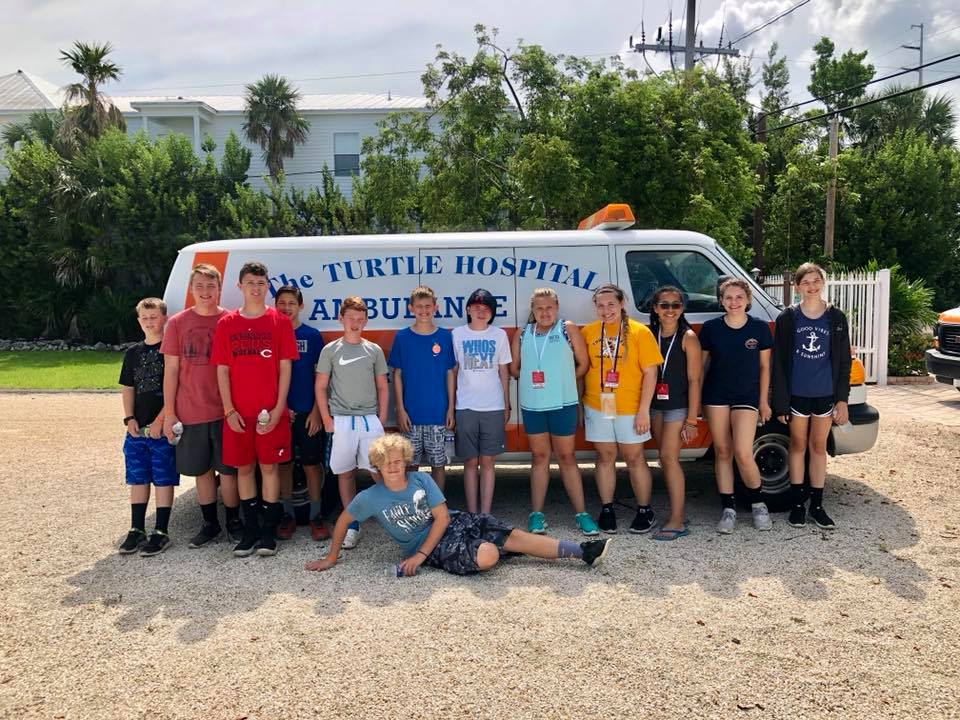 students visiting a sea turtle hospital in Florida